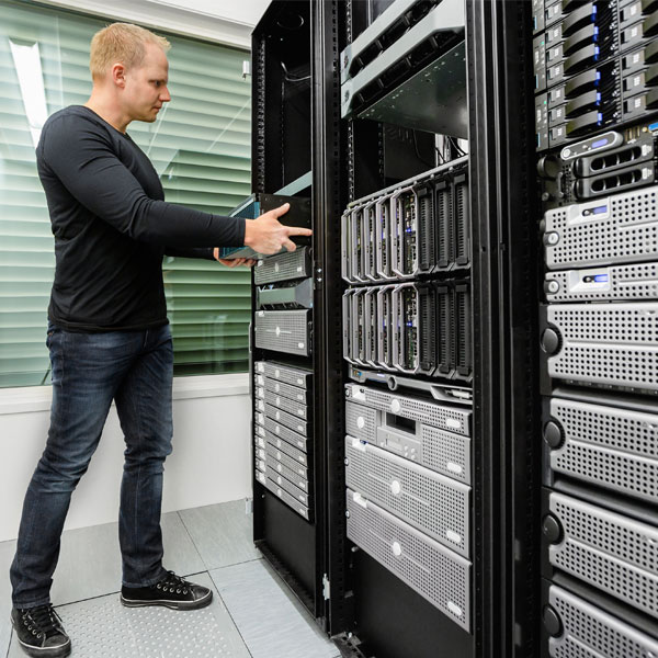 Man setting up server room